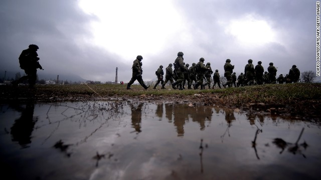 Russian soldiers patrol the area surrounding a Ukrainian military unit in Perevalnoye, Crimea, on Thursday, March 20.