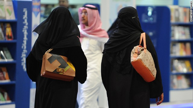 Fully veiled Saudi women browse the annual International Book Exhibition in the capital Riyadh on March 4, 2014.