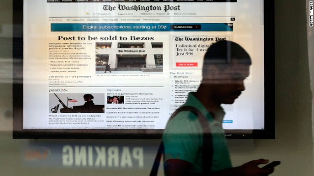 A man leaves the Washington Post building after the announced sale of the newspaper August 5, 2013 in Washington, DC.