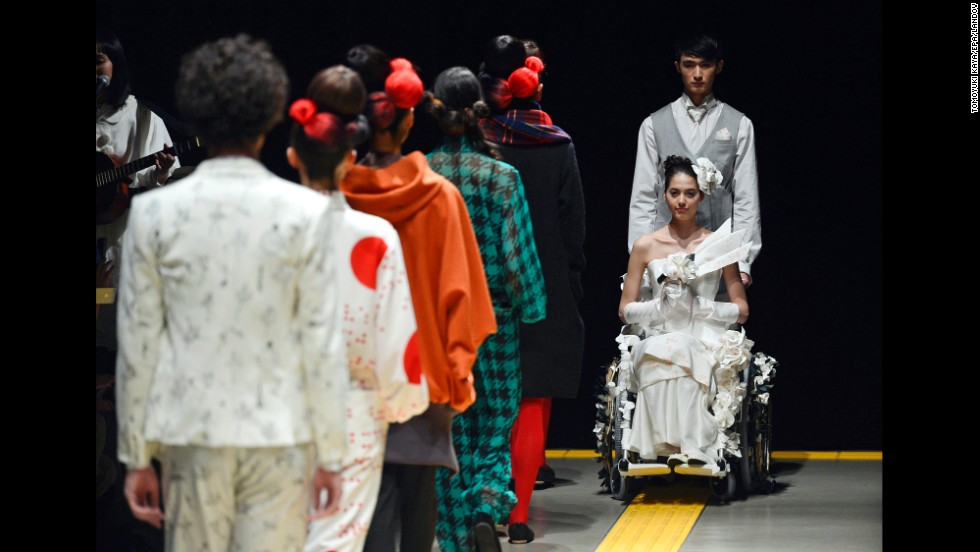 Models present creations by Japanese designer Takafumi Tsuruta for the fashion label ha ha on Tuesday, March 18, during Mercedes-Benz Fashion Week in Tokyo.