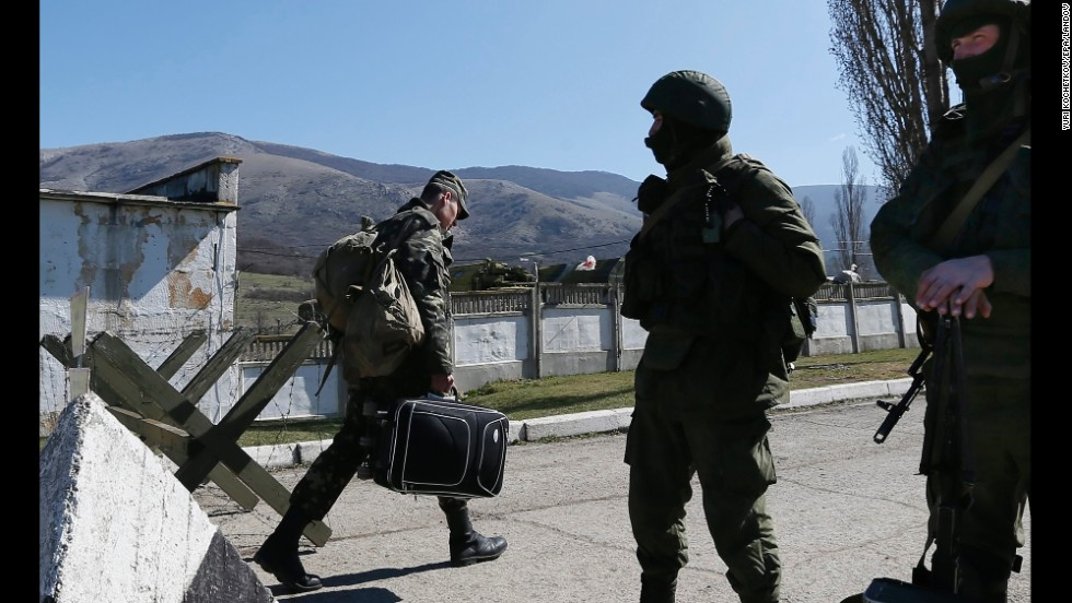 A Ukrainian serviceman leaves a Ukrainian military unit that Russian soldiers took control of in Perevalne on March 21.