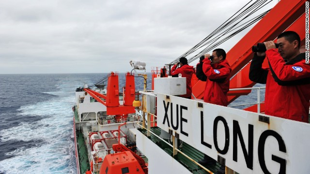 Crew members on search duty on board the Chinese icebreaker Xuelong on March 23, 2014.