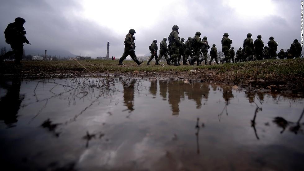 Ukraine orders Crimea troop withdrawal as Russia seizes naval base