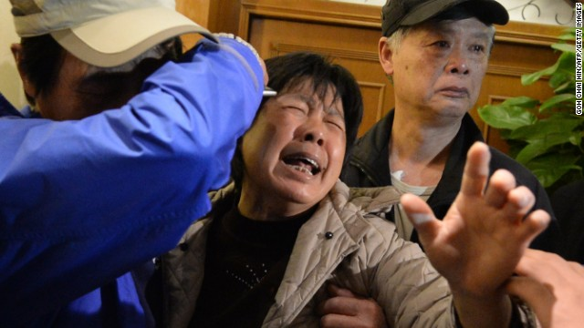 MH370 families react with 'raw emotion'