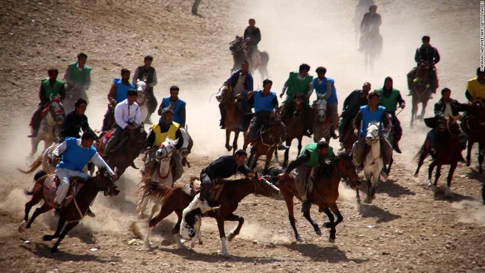 Afghan horsemen struggle to control a headless goat carcass during a game of buzkashi in Bamiyan, Afghanistan, on Sunday, March 23.