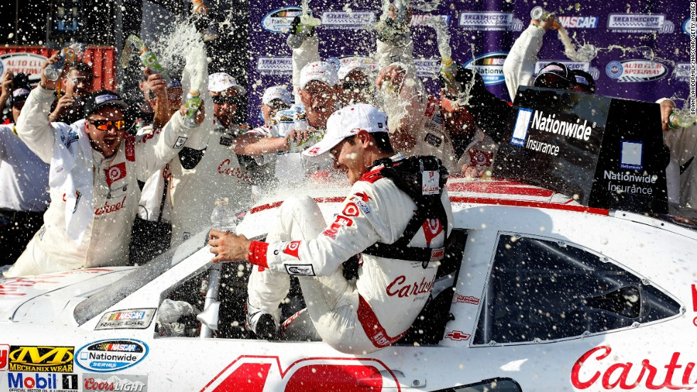 NASCAR driver Kyle Larson celebrates in Victory Lane after winning the Nationwide Series race in Fontana, California, on Saturday, March 22.