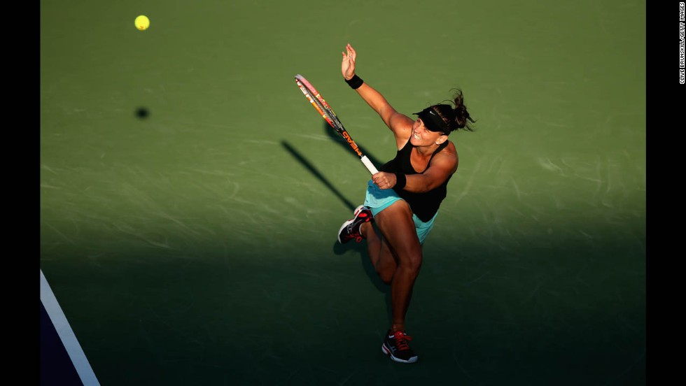 Casey Dellacqua returns a shot against Venus Williams during their third-round match Sunday, March 23, at the Sony Open in Key Biscayne, Florida.