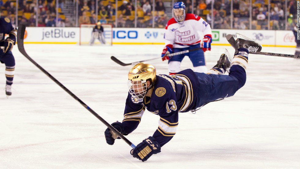 "Notre Dame's Vince Hinostroza is tripped while playing Massachusetts-Lowell in the semifinals of the Hockey East Championship on Friday, March 21. <a href=""http://www.cnn.com/2014/03/18/worldsport/gallery/what-a-shot-0318/index.html"">See 26 amazing sports photos from last week</a>"