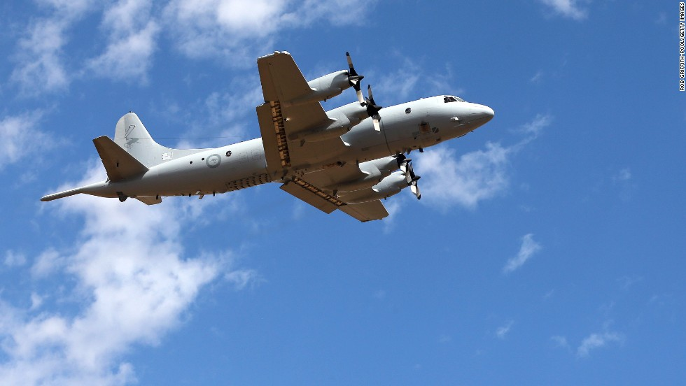 A Royal Australian Air Force AP-3C Orion takes off from the Pearce air base in Perth, Australia, to join the search for Malaysia Airlines Flight 370 on Sunday, March 23.