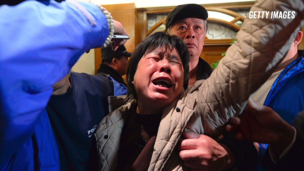 Flight 370: Storm of emotions over lives 'lost' as storm at sea delays search