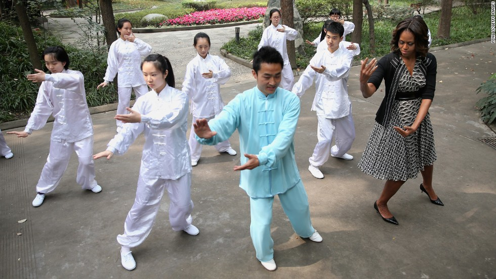 "The first lady of the United States, Michelle Obama, learns tai chi in Chengdu, China, on Tuesday, March 25. Obama's <a href=""http://www.cnn.com/2014/03/21/politics/gallery/michelle-obama-china/index.html"">weeklong trip to China</a> focused on broadening ties between China and the United States."