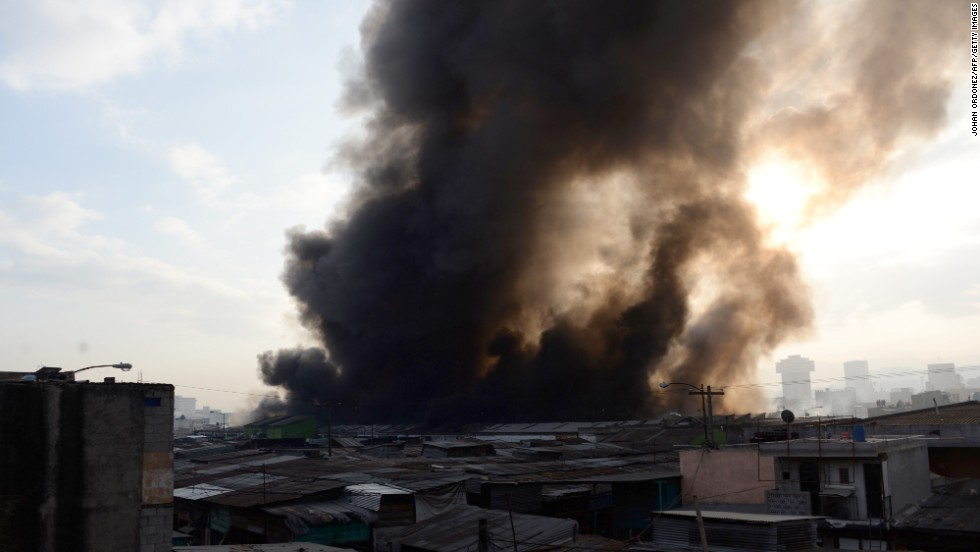 Dense smoke billows from a fire at the market.