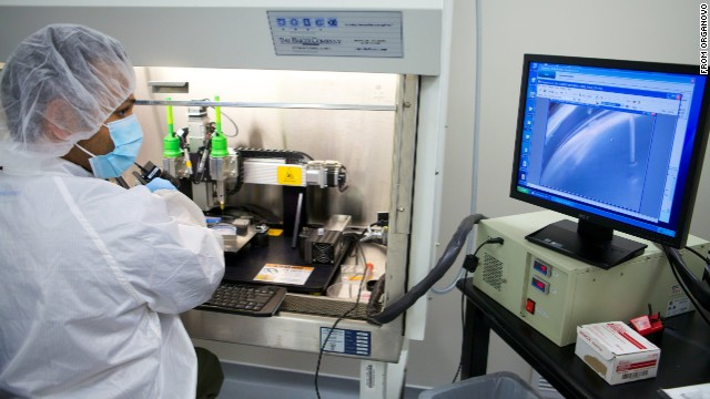 One of Organovo's engineers oversees the construction of a vascular tissue construct on a NovoGen MMX bioprinter.