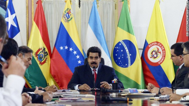 Venezuelan President Nicolas Maduro (C) speaks during an UNASUR's foreign ministers meeting at the Miraflores Presidential Palace in Caracas on March 25, 2014. Venezuela has arrested three air force generals suspected of plotting an uprising against the leftist government, President Nicolas Maduro said Tuesday. Maduro told a meeting of South American foreign ministers that the three generals, who were not identified, had been in contact with the opposition and 'were trying to rise up against the legitimately constituted government.' AFP PHOTO/LEO RAMIREZ (Photo credit should read LEO RAMIREZ/AFP/Getty Images)