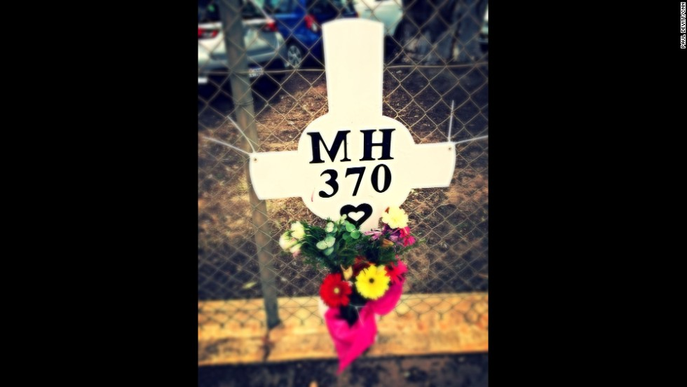 """Flower memorial sits on the fence of RAAF Pearce in Perth. It is dedicated to those 239 people who lost their lives on flight MH370."" By CNN's Paul Devitt, March 26.   Follow Paul on Instagram at <a href=""http://instagram.com/devohk"" target=""_blank"">instagram.com/devohk</a>."