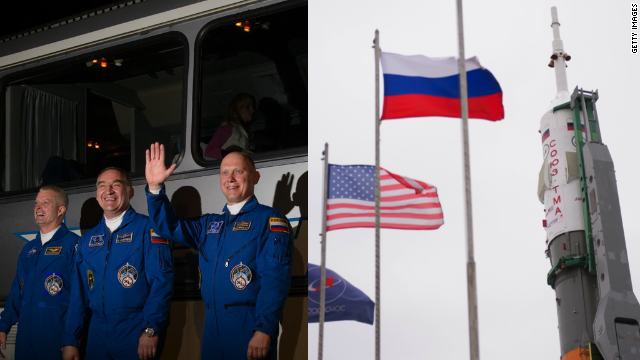 Steve Swanson of NASA, Alexander Skvortsov and Oleg Artemyev of the Russian Federal Space Agency are riding inside the Soyuz TMA-12M spacecraft (right).