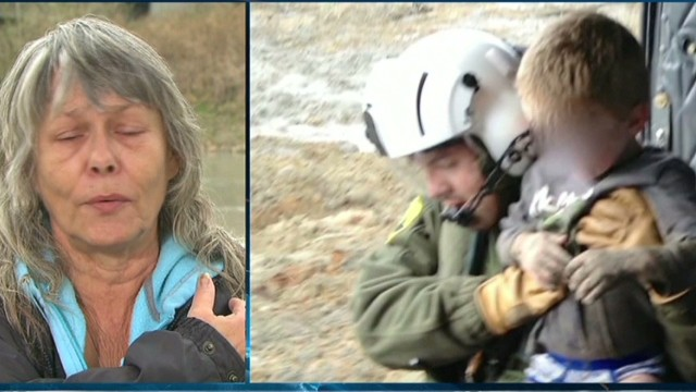 Mudslide survivor Robin Youngblood says she helped keep a 4-year-old boy calm.