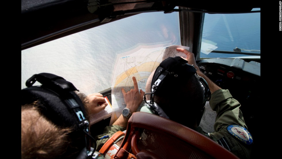 Flight Lt. Jayson Nichols looks at a map aboard a Royal Australian Air Force aircraft during a search on March 27, 2014.