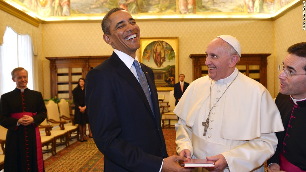 "U.S. President Barack Obama exchanges gifts with Pope Francis after meeting him at the Vatican on Thursday, March 27. It was the <a href=""http://www.cnn.com/2014/03/27/politics/gallery/obama-meets-pope-francis/index.html"">first-ever meeting</a> between the two, and it had its share of light moments."