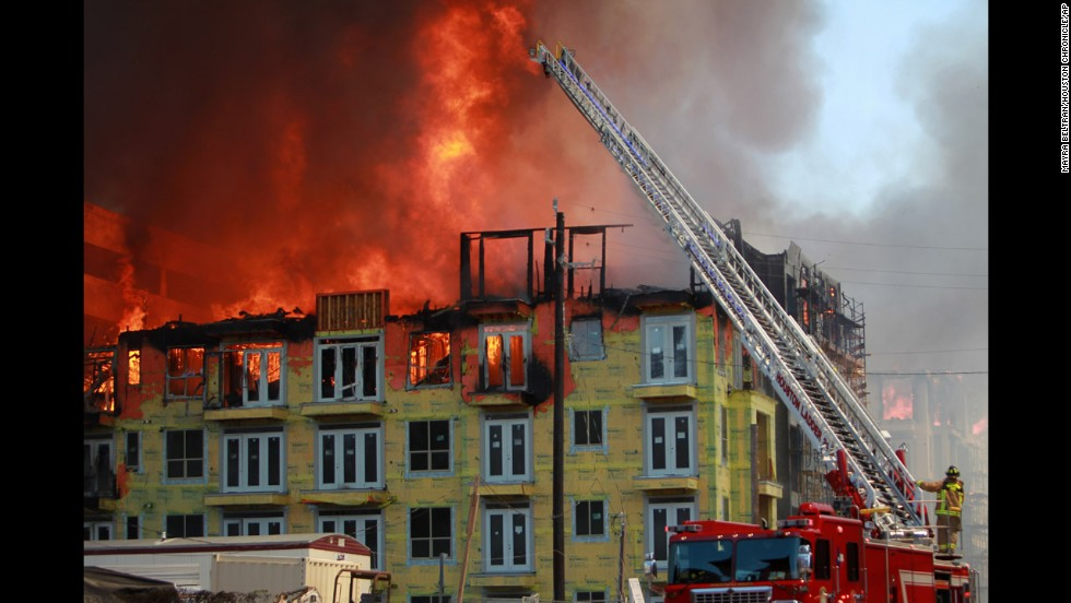 "Firefighters try to extinguish a five-alarm blaze at a construction site in Houston on Tuesday, March 25. <a href=""http://ac360.blogs.cnn.com/2014/03/26/inside-the-houston-construction-inferno-rescue/"">A dramatic rescue</a> was caught on video."