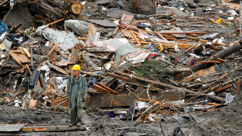 A searcher walks near a massive pile of debris in Oso on March 27.