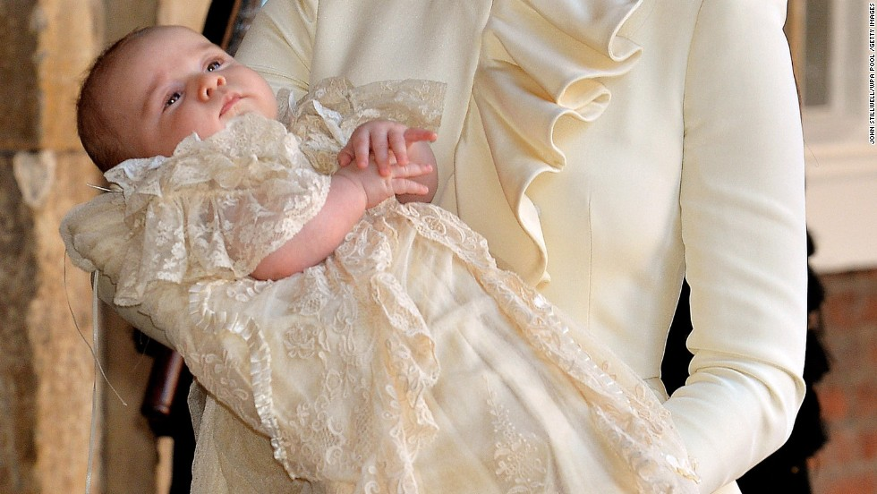Catherine carries her son after his christening.