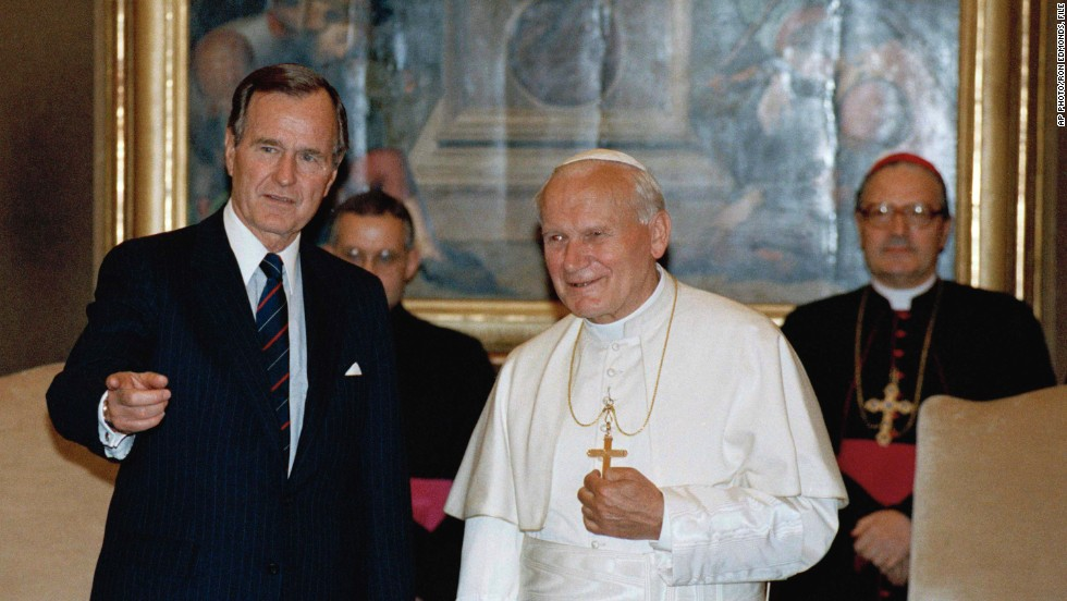 May 27, 1989, President George H.W. Bush gestures while standing with Pope John Paul II in the papal library at the Vatican.