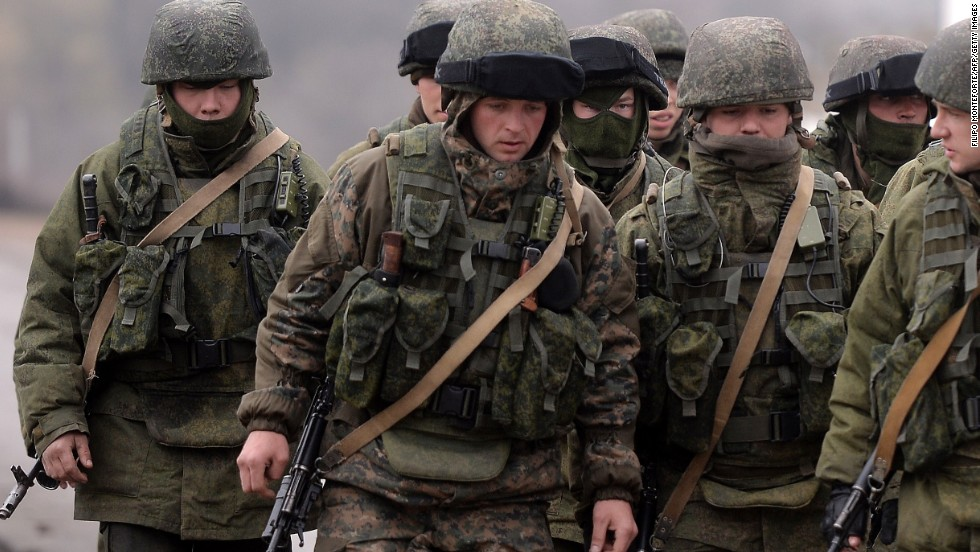 Germany: Putin says he's pulling some troops back from Ukrainian border