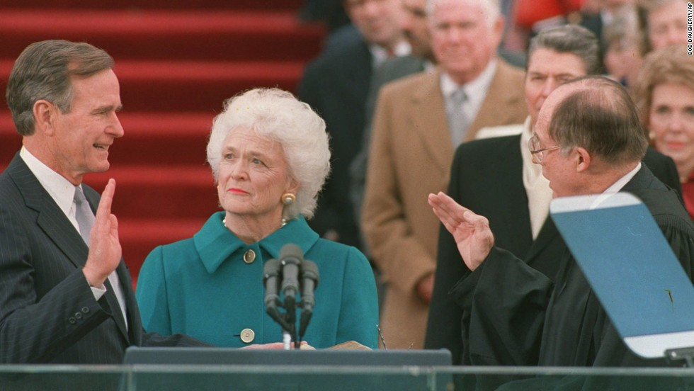 Bush was sworn into office as the 41st President of the United States on January 20, 1989. First lady Barbara Bush holds the Bible for her husband while Chief Justice William Rehnquist administers the oath of office.
