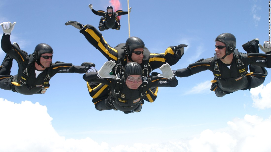 Celebrating his 80th birthday in 2004, Bush performs one of two jumps he completed with the Army Golden Knights over the Bush Presidential Library.