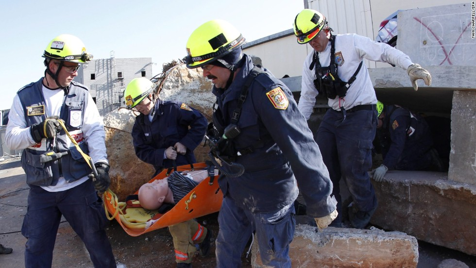 Task Force members rescue a dummy victim at the scene of a mock subway explosion.