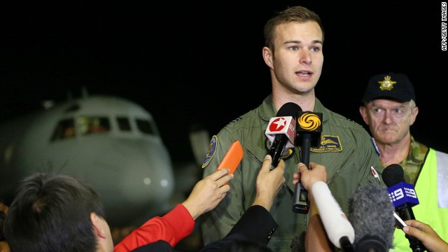 Flight Lieutenant Russell Adams talks to waiting media upon his crew's return from searching the southern Indian Ocean for Malaysian Airlines Flight MH370 aboard a Royal Australian Air Force AP-3C Orion aircraft At RAAF Pearce Air Base in Bullsbrook, some 35kms north of Perth, on March 30, 2014.