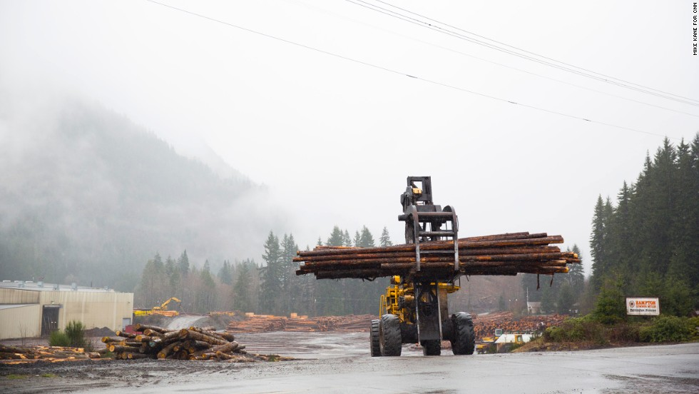 Timbers are moved at a lumberyard just outside of Darrington on Saturday. Darrington's economy is largely dependent on the logging and timber injuries, which took a hit in the 1970s. The town has never fully recovered.