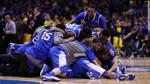 Kentucky, the No. 8 seed in its region, celebrates after freshman Aaron Harrison's late 3-pointer held up for the win.