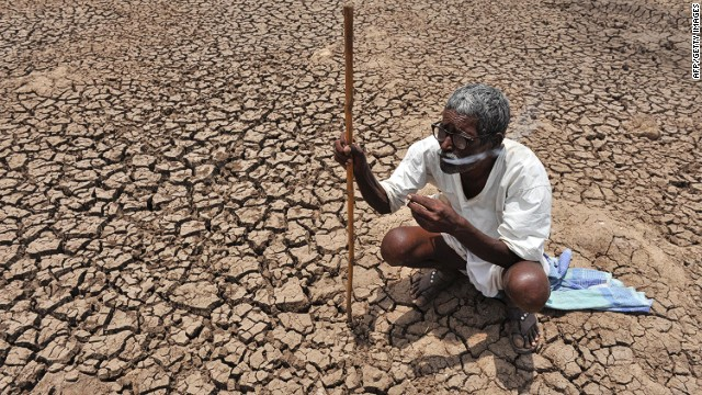 In this file photo taken on June 7, 2010, an Indian shepherd rests in the dry lakebed of Osman Sagar Lake, commonly known as Gandipet, on the outskirts of Hyderabad.