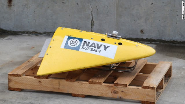 A sensor for the towed pinger locator sits on the wharf at a naval base in Perth, Australia, on Sunday, March 30.