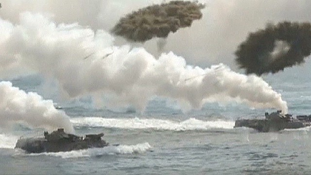 North, South Korea exchange fire at sea
