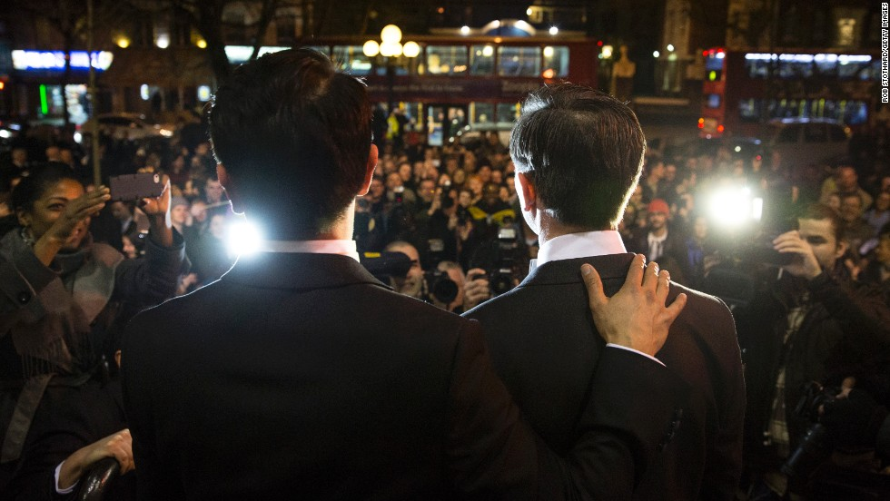 "MARCH 31 - LONDON, UK: Gay couple Peter McGraith (right) and David Cabreza speak to the press after getting married shortly after midnight at Islington Town Hall at one of the UK's first same-sex weddings on March 29. <a href=""http://www.cnn.com/2014/03/28/world/europe/uk-same-sex-marriage/""> England and Wales are among 15 countries</a> as well as parts of the United States and Mexico that allow gay marriage."