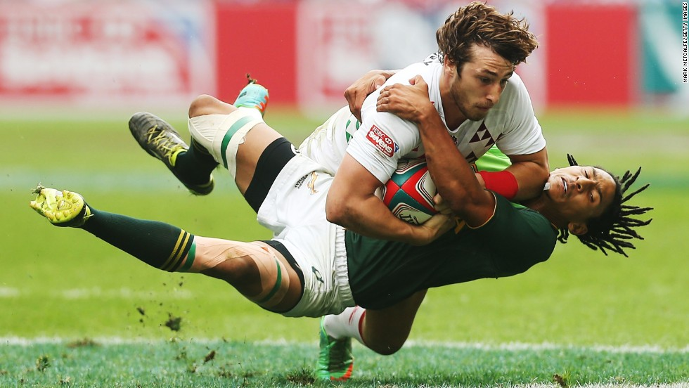 England's Dan Bibby is tackled by South Africa's Justin Geduld during the Hong Kong Sevens tournament on Sunday, March 30.