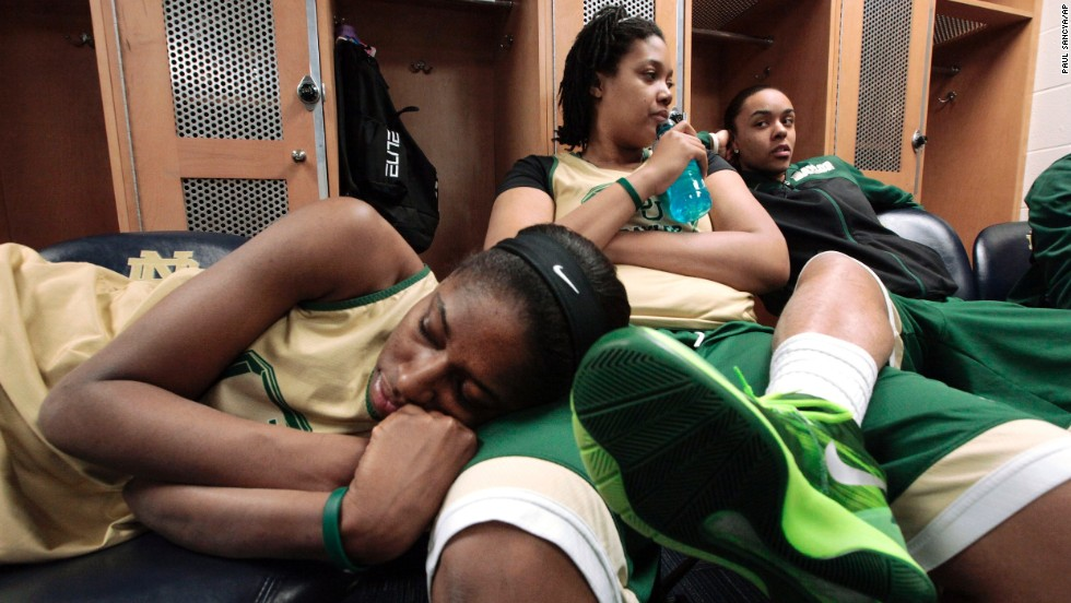 From left, Baylor basketball players Khadijiah Cave, Kristina Higgins and Mariah Chandler relax in the locker room before a practice Sunday, March 30, in South Bend, Indiana.