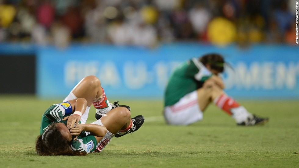 "Mexican soccer players are dejected after losing to Japan in the quarterfinals of the FIFA U-17 Women's World Cup on Thursday, March 27. <a href=""http://www.cnn.com/2014/03/25/worldsport/gallery/what-a-shot-0325/index.html"">See 30 amazing sports photos from last week</a>"