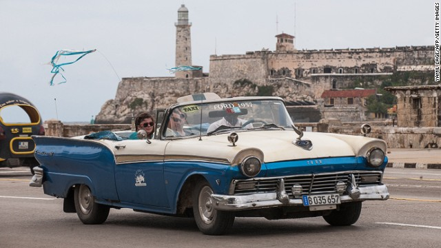 Tourists travel in a taxi, on January 8, 2014 in Havana.