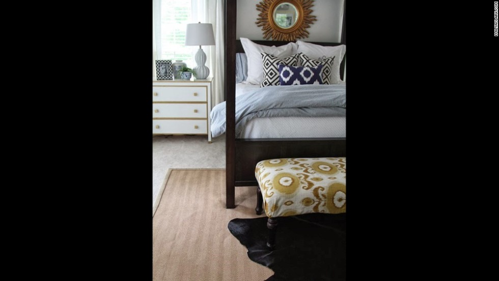 Clark layers rugs and blue bedding for a rich mix of texture and color in her master bedroom.