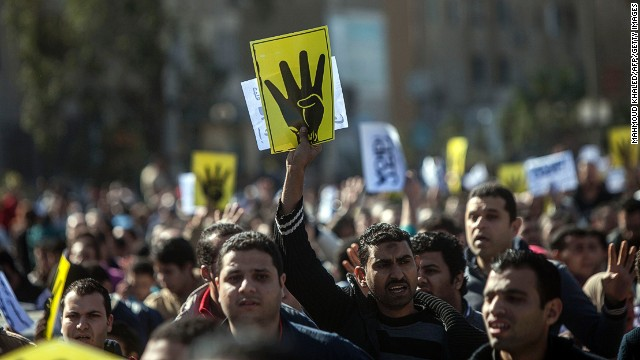 Supporters of the Muslim Brotherhood chant slogans and raise four fingers, the symbol known as 'Rabaa', which means four in Arabic, remembering those killed in the crackdown on the Rabaa al-Adawiya protest camp in Cairo last year, during a demonstration in Cairo on January 24, 2014.