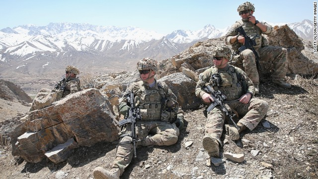 U.S. soldiers rest along a ridgeline on March 31, 2014 near Pul e Alam, Afghanistan.