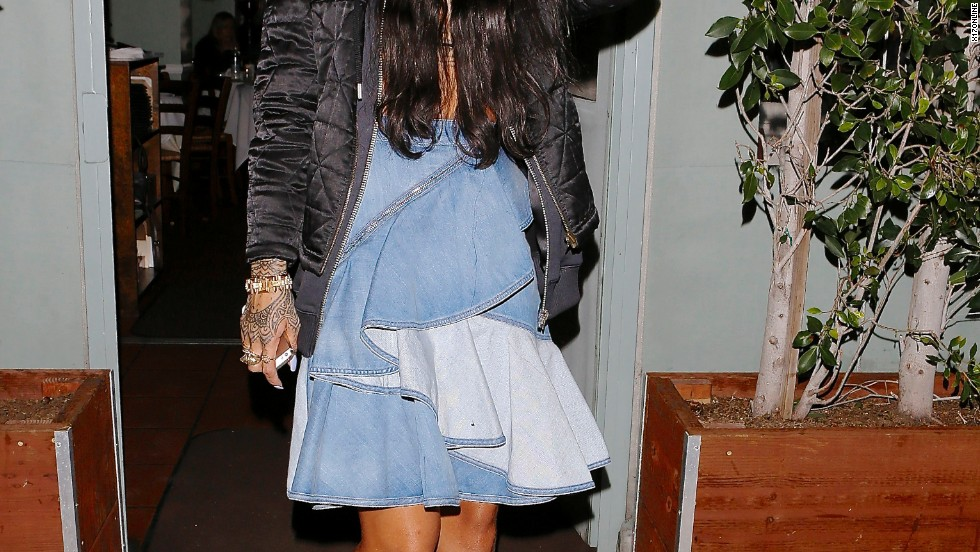 Rihanna tries to avoid the glare of the camera flashes on March 29.