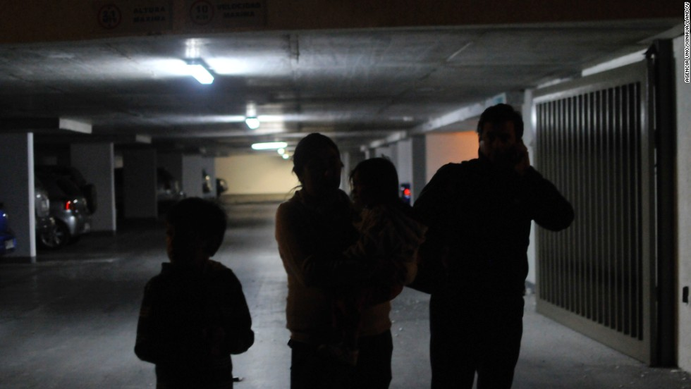 Iquique residents wait in a parking garage after the earthquake.