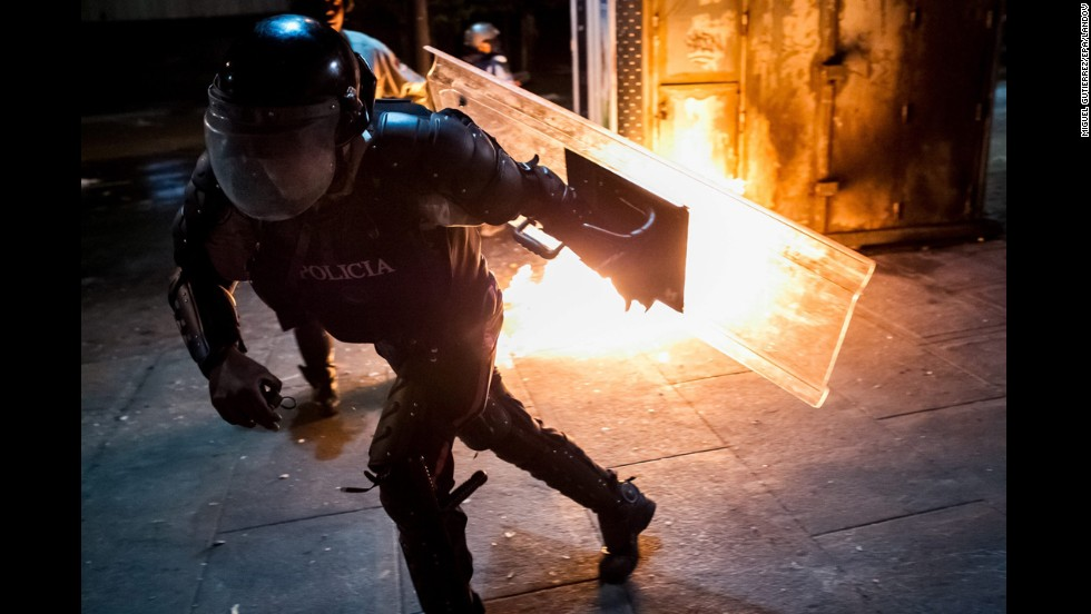 Members of Venezuela's National Police clash with demonstrators in the Cachao sector of Caracas on Monday, March 31.