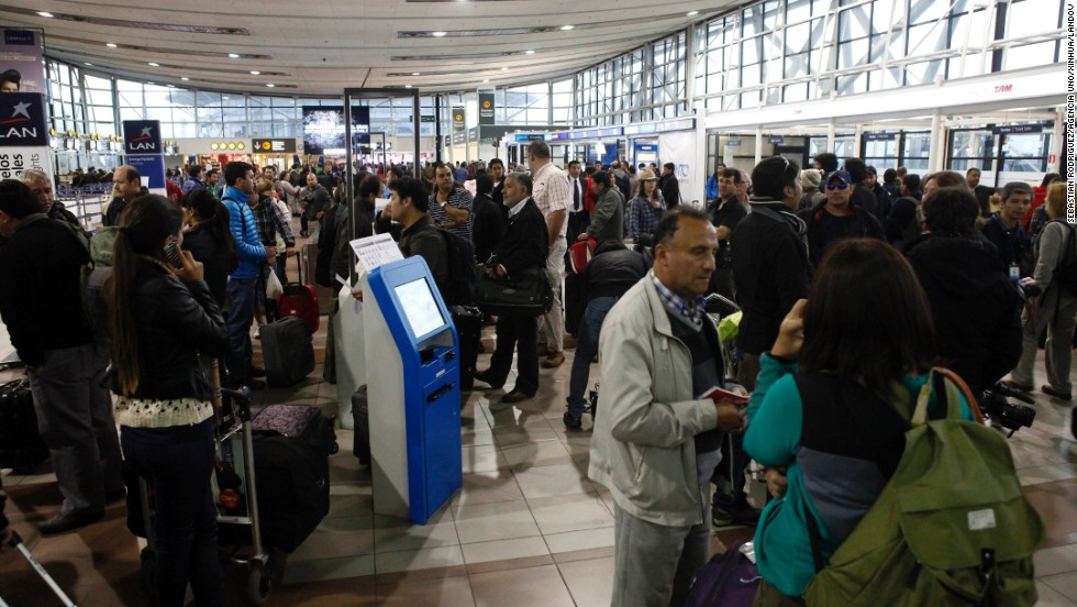 People wait at the Arturo Merino Benitez Airport in Santiago, Chile, on April 2 as flights are canceled because of the earthquake.