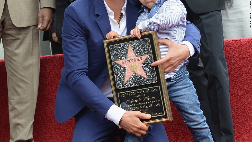 Orlando Bloom has help from his son Flynn as he accepts a star on the Hollywood Walk of Fame on April 2.